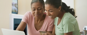 Mother and daughter shopping online