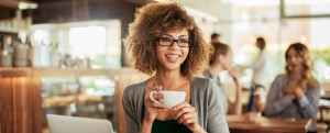 A young woman enjoying morning coffee in cafe
